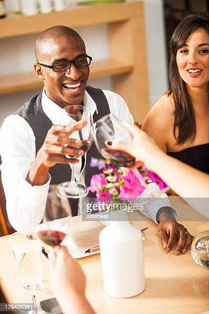 diverse friends toasting glasses - valentines african american stock pictures, royalty-free photos & images