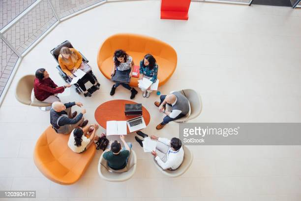 diverse group discussion - organised group stock pictures, royalty-free photos & images