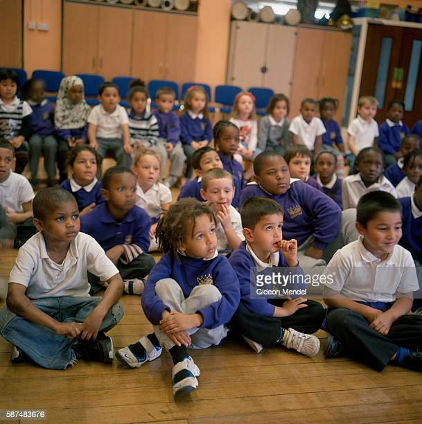Diverse group of children at Kingsmead Primary School pay close attention during a school assembly. The school primarily serves children who live on...