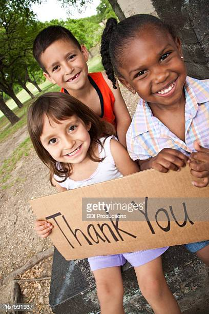 Diverse Group of Children Holding Thank You Sign