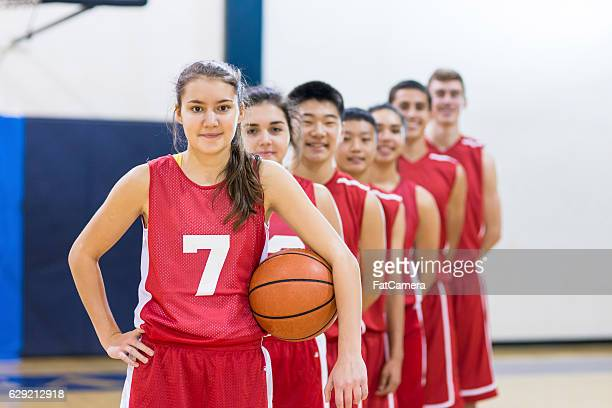 Diverse group of co-ed basketball players in a line
