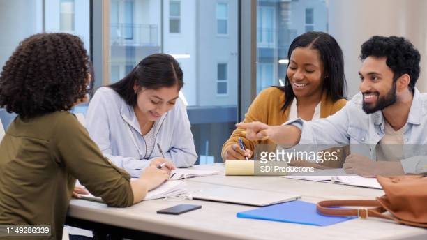 diverse group of college students studying in library - science photo library stock pictures, royalty-free photos & images
