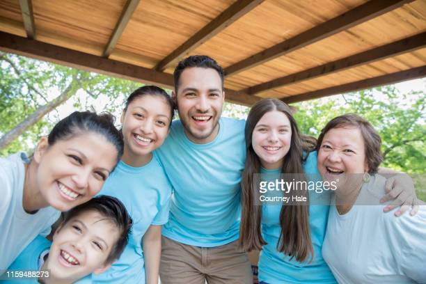 diverse group of community volunteers smile for photo together outdoors - guam stock pictures, royalty-free photos & images