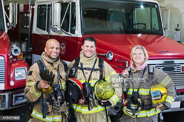 diverse group of fire fighters at the station - firefighter stock pictures, royalty-free photos & images