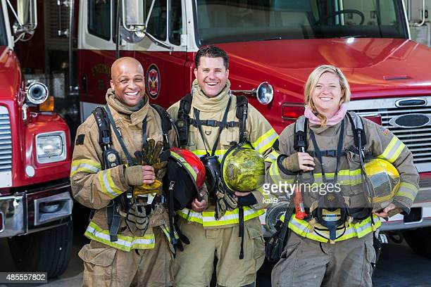 diverse group of fire fighters at the station - fire station stock photos and pictures