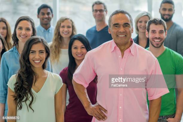 diverse group of happy individuals - multigenerational family stock pictures, royalty-free photos & images