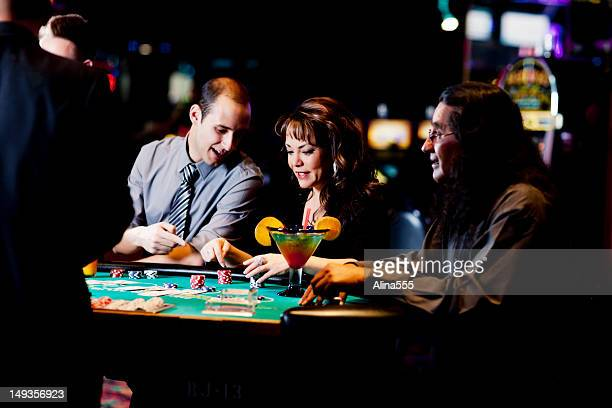 Diverse group of happy people at the blackjack table