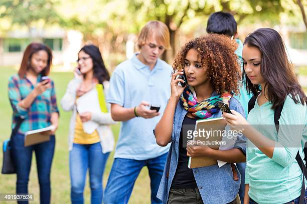 Diverse group of high school/college students using smart phones