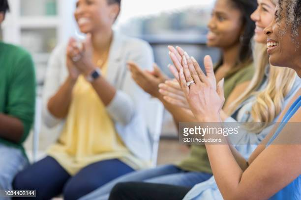 diverse group of people applauding - group therapy stock pictures, royalty-free photos & images