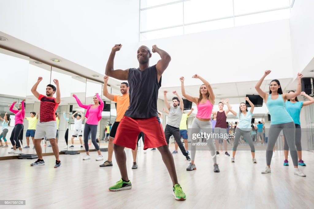 Diverse group of people at a rumba lesson in the gym : Stock Photo