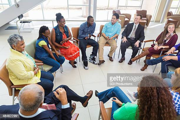 Diverse group of people in a meeting together