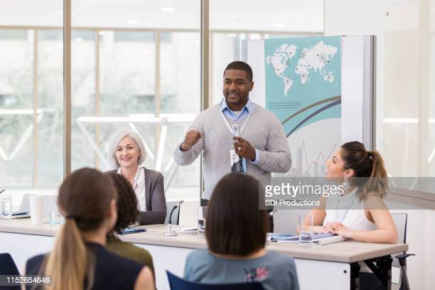 diverse group of people listen to speaker attentively - panel discussion stock pictures, royalty-free photos & images