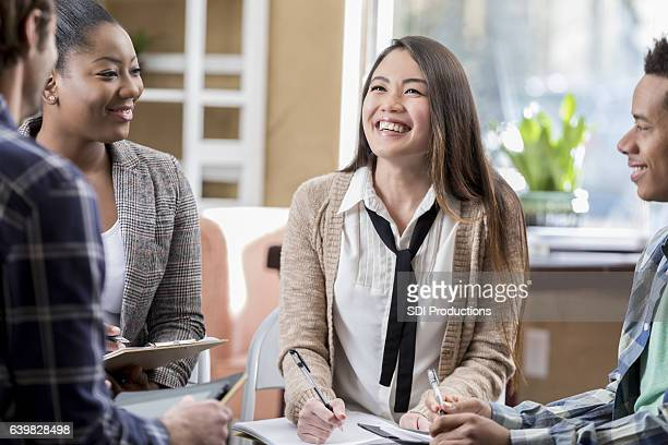 diverse group of people meet to discuss something - book club meeting stock pictures, royalty-free photos & images
