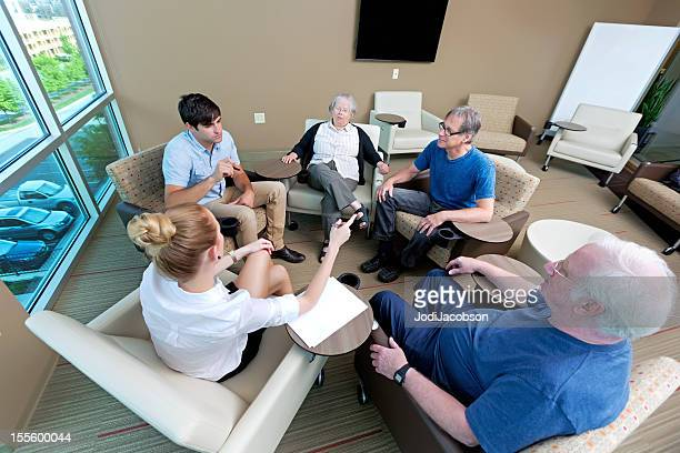 Diverse group of people meeting indoors