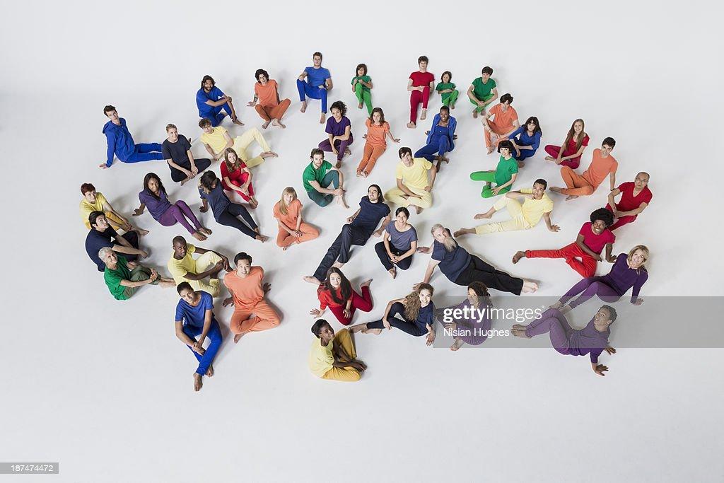 Diverse Group of People Reclining on Studio Floor : Stock Photo