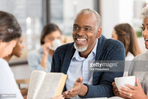 diverse group of people studying the bible - smiling jesus stock pictures, royalty-free photos & images