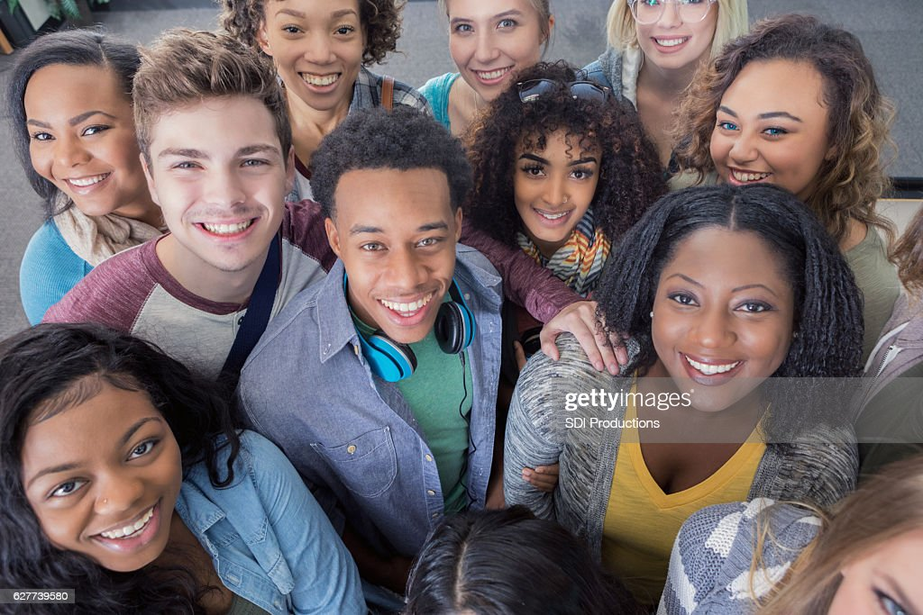 Diverse group of smiling young adults : Stock Photo