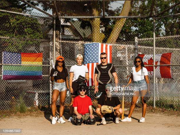 diverse group of softball players - hot teen stock pictures, royalty-free photos & images