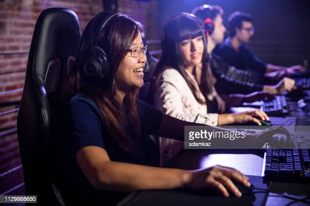 diverse group of students playing esports - gamer stock pictures, royalty-free photos & images