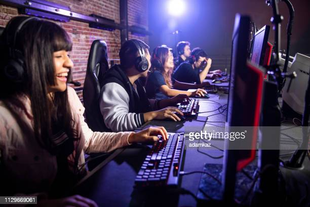 diverse group of students playing esports - esport stock pictures, royalty-free photos & images