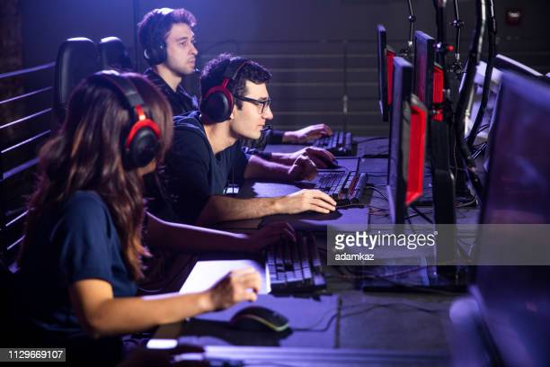 diverse group of students playing esports - esports stock pictures, royalty-free photos & images