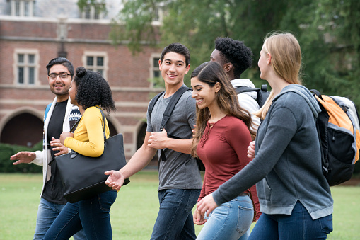 Diverse Group of University Students Walking on Campus - gettyimageskorea