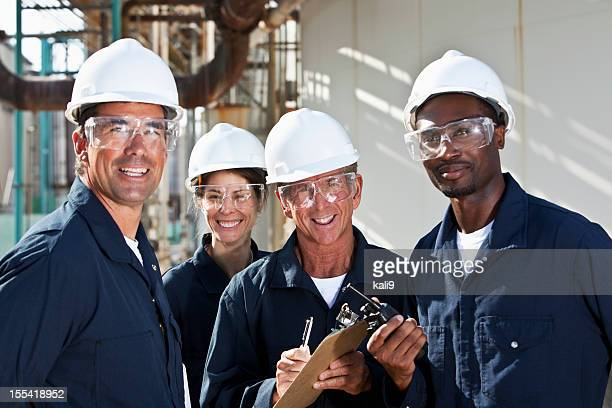 Diverse group of workers at manufacturing plant