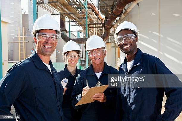 diverse group of workers at manufacturing plant - protective eyewear stock pictures, royalty-free photos & images