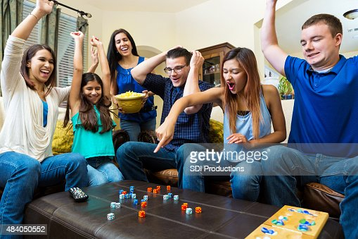 diverse group of young adult friends playing competitive fun game stock photo getty images. Black Bedroom Furniture Sets. Home Design Ideas
