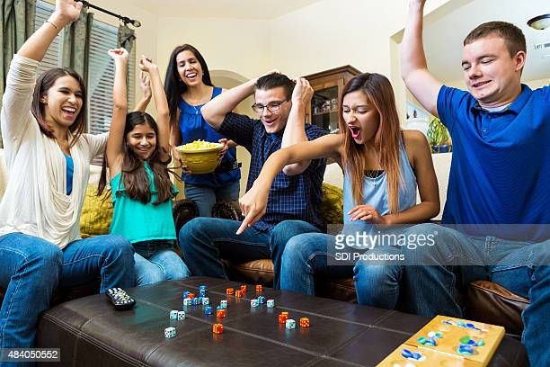 Diverse group of young adult friends playing competitive fun game