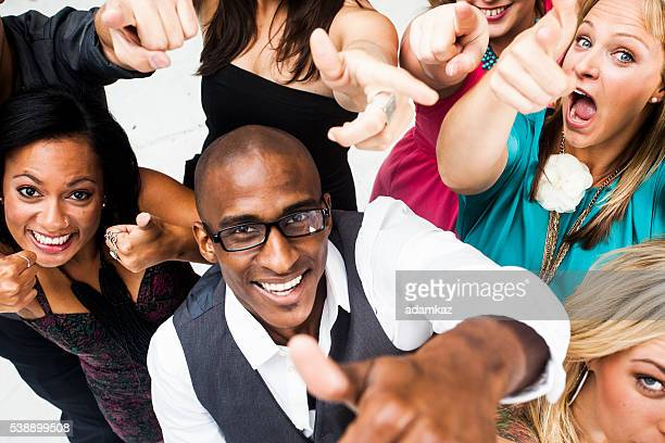 Diverse Group of Young Adults Giving Thumbs Up