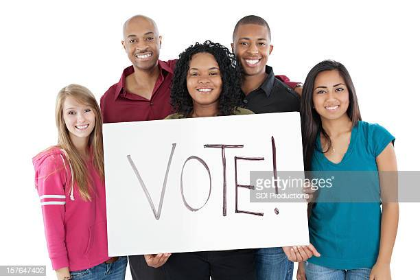 Diverse Group of Young Adults Holding Vote Sign