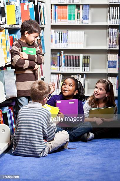 Diverse group of young children in library