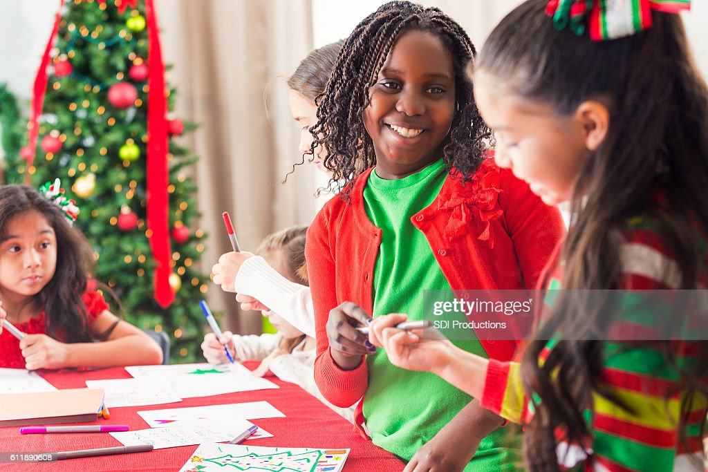 Diverse Group Of Young Girls Making Crafts For Christmas Stock Photo