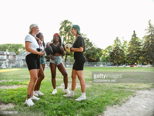 diverse group of young women taking a break - softball sport stock pictures, royalty-free photos & images