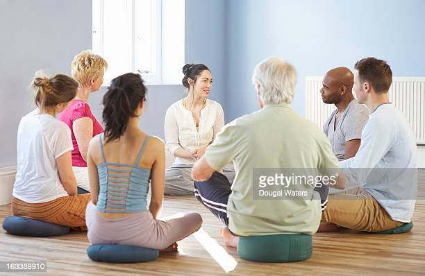 Diverse group seated in a circle.