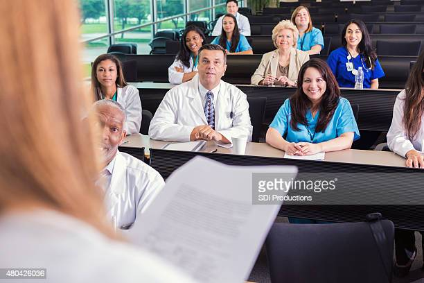 Diverse healthcare professionals attending medical conference or lecture