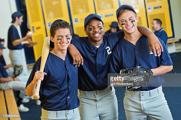 diverse high school baseball players in locker room - baseball team stock pictures, royalty-free photos & images