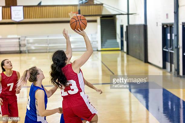 Diverse high school female basketball team playing a game
