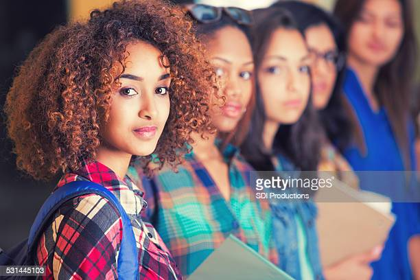 Diverse high school or college girls standing in line