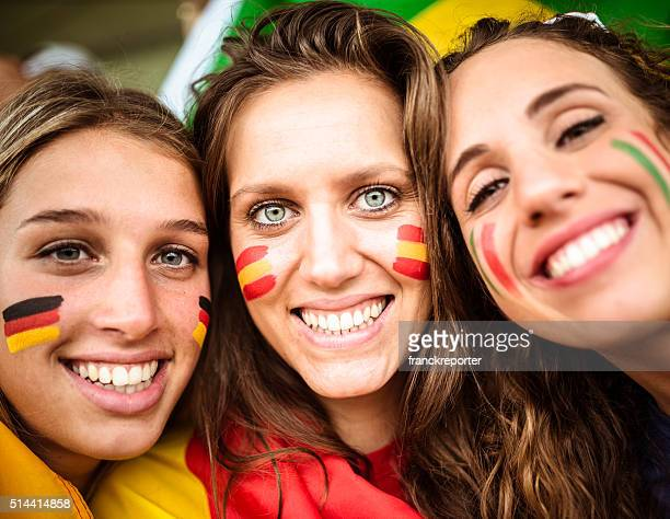 Diverse italy spain germany friends supporters at stadium