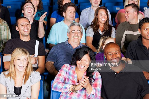 Diverse large group of people watching an exciting game
