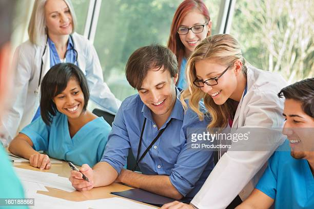 Diverse medical team working together on diagnosis research