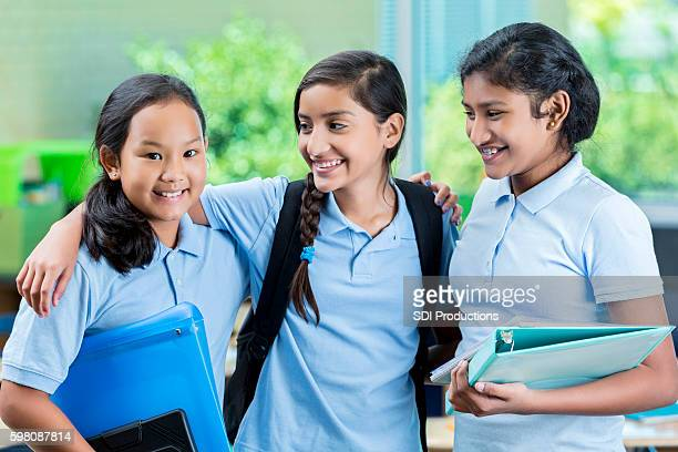 diverse middle school girls before class - charter_school stock pictures, royalty-free photos & images