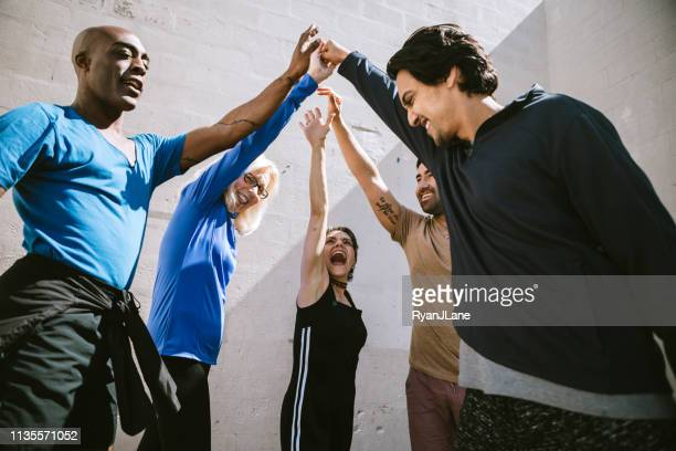 diverse outdoor multigenerational dance class group - dance troupe stock pictures, royalty-free photos & images