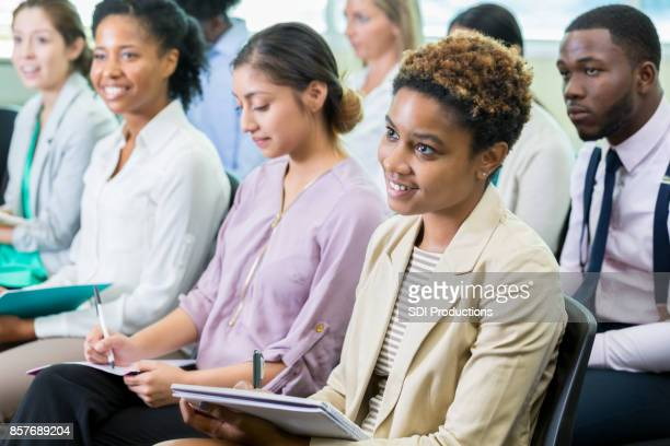 Diverse people attend continuing education class