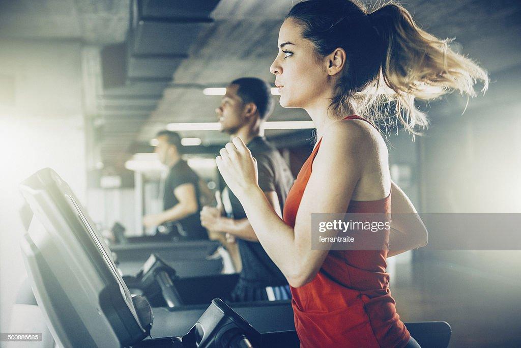 Diverse People Running on Treadmill : Stock Photo