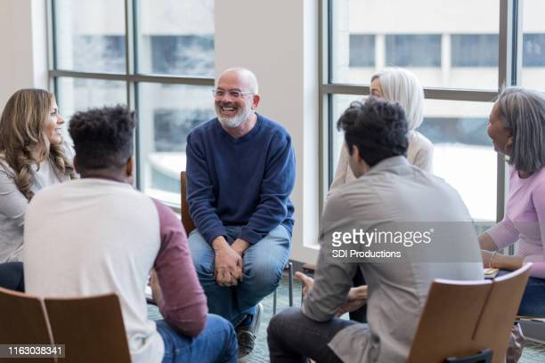 diverse people sit in circle and brainstorm ideas - group therapy stock pictures, royalty-free photos & images