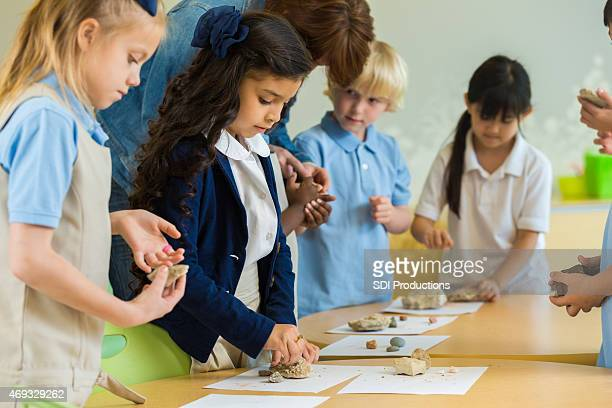 Diverse private elementary school students in earch science class