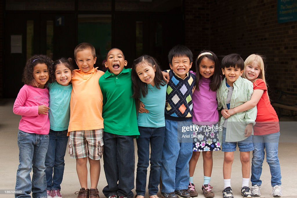 Diverse students standing together in a row : Stock Photo